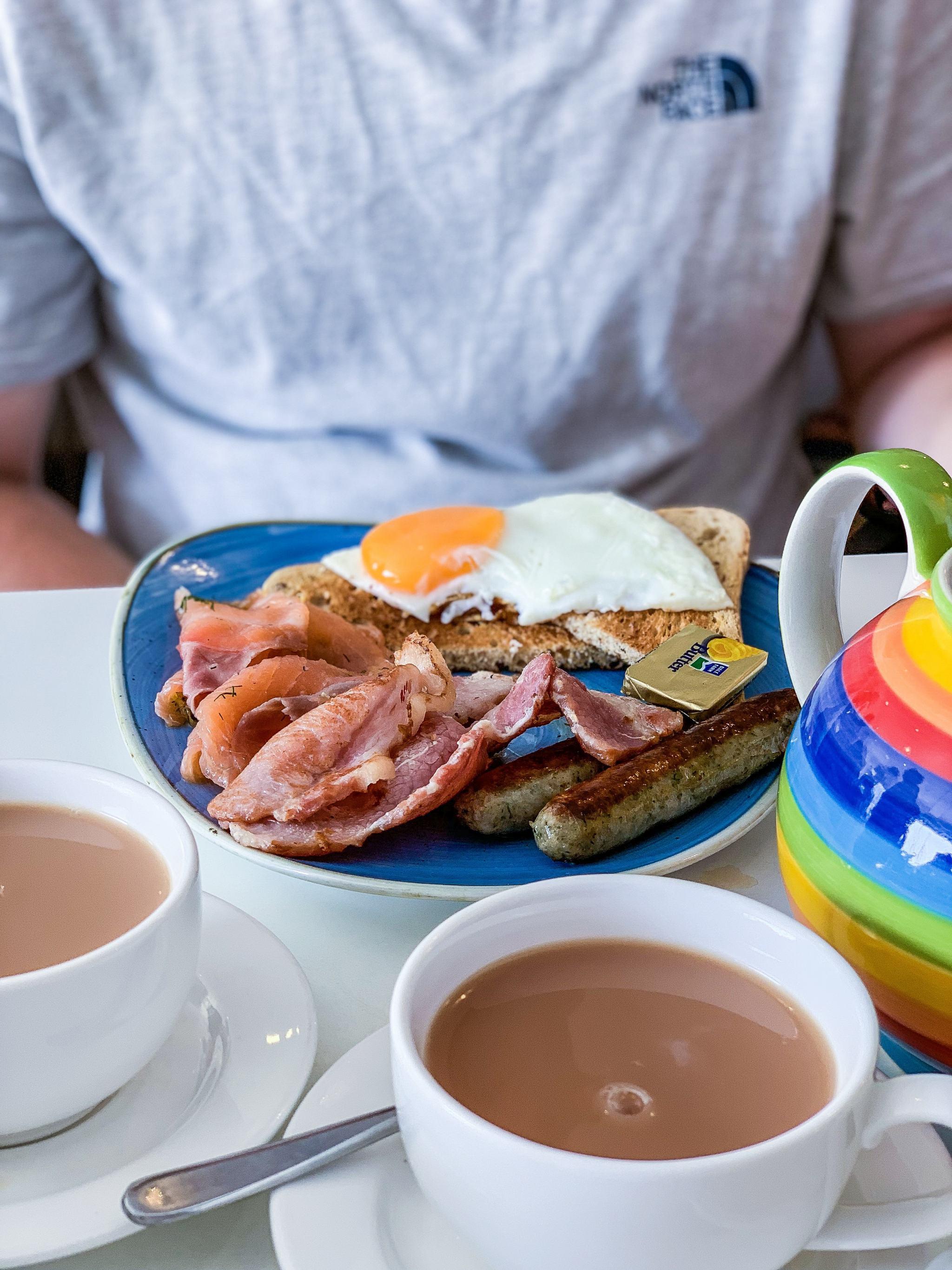 bacon, smoked salmon, sausage and egg breakfast